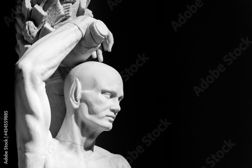 Fototapeta Black and white photo of ancient roman sculpture of a bold man with an elfic ear