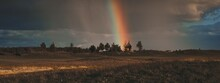Landscape With Sky After Rain At Sunset With Rainbow