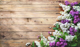 Blooming lilac flowers (syringa vulgaris) on rustic wooden background - 434590007
