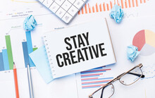 Notepad With Text Stay Creative On The Business Charts And Pen,business