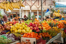 Counter Of Street Market Stall With Various Fruits, Red And Yellow Apples, Oranges, Bananas, Pineapples. Authentic Local Market Of Fresh Farming Produce.