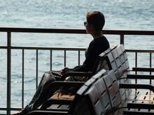 Girl Crossing The Bosphorus In Istanbul