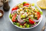 Fototapeta Kawa jest smaczna - Healthy spring Greek salad with fresh vegetables and chickpeas