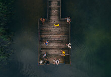 Wooden Pier On The Lake And People Resting On It Top View