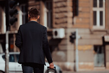 Businessman With Suitcase Walks Down The Street