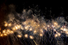 Fireworks And Sparkles In A Dark Night Sky