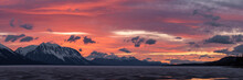 Stunning Sunset Over Snow Capped Mountain Peaks In Northern Canada During Spring Time With Purple, Peach And Pink Colors In Natural, Wild Setting. Taken In Warm Bay, Atlin, British Columbia, Canada.