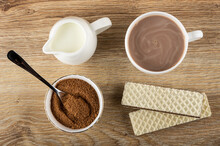 Pitcher With Milk, Cup Of Cocoa With Milk, Cocoa With Sugar, Spoon In Bowl,  Wafers With Porous Chocolate On Table. Top View