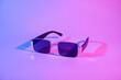 Leinwandbild Motiv Stylish sunglasses on color background