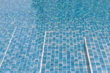 Stairs In Swimming Pool With Water