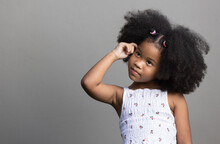 Portrait Of African American Curly Hair Girl Thinking Something And Looking Up.
