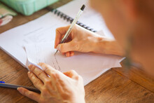 Womans Hand Writing Notes On Paper.