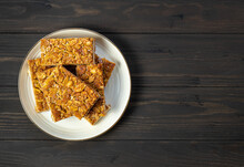 Florentines Or Bee Sting, Thin Shortbread Cookies Covered With Candied Almond With Honey.