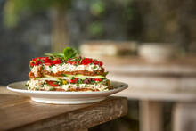Vegetarian Lasagna On A White Plate In An Outdoor Kitchen.