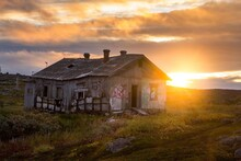 Sunset On The Background Of An Abandoned House