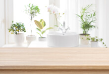 Blank Tabletop For Product Display With Blurred Bathroom Sink Background