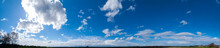 Panorama Of Sunny And Stormy Sky On A Background Of Mountains