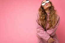 Attractive Amusing Young Blonde Woman Wearing Everyday Stylish Clothes And Modern Sunglasses Isolated On Colorful Background Wall Looking Up And Having Fun