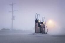 Old Fashioned Gas Pumps On A Foggy Street At Dawn, Australia