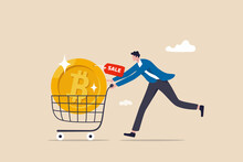 Buying Bitcoin On Sale When Cryptocurrency Price Crash To Make Profit Concept, Smart Man Buying Or Purchasing Crypto Currency Bitcoin In Shopping Cart Trolley To Speculate Earning In The Future.