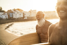 Father And Son Having Fun On The Beach After Surf Session - Focus Senior Man Face