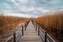 Wooden Bridge Leading Through Marshes And Lakes Inside The Central Anatolian Sultan Reedy (Sultansazligi) National Park, Turkey