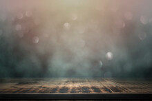 Empty Wooden Table With Smoke Float Up On Abstract Blurred Bokeh Lights Background, Used As A Studio Background Wall To Display Your Products