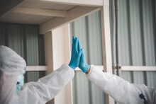Team Of Epidemic Experts Encouraged Themselves To Clean Up Overall Safety And Disinfect Apartments With Detergent Sprays During The COVID-19 Outbreak.
