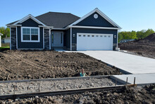 New Home Sidewalk And Driveway Construction With A Concrete Cement Foundation By Builders For A Smooth Surface
