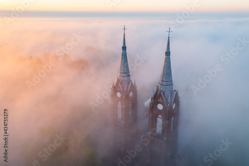 Canvas The towers of Vilkija church at sunrise