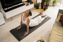 Woman Wearing Sportswear Practicing Yoga And Doing Cobra Exercise