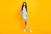 Photo Of Charming Young Brunette Lady Posing Hand Hip Wear Blue Dress Footwear Isolated Yellow Color Background