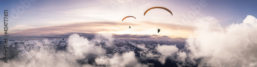 Fotografia, Obraz Adventure Composite Image of Paraglider Flying up high in the Rocky Mountains