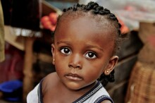 Portrait Of A Cute Little Girl With Big Eyes