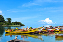 Wide Shot Of Colorful Fishing Boats Docked At The River Mouth. Punts Parked At The Riverside.