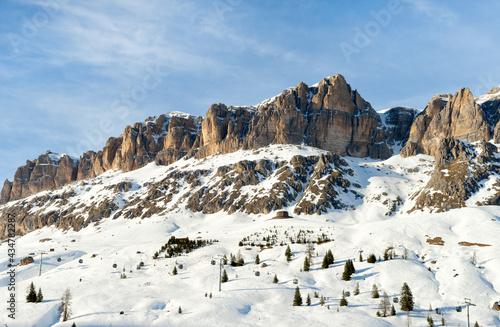 View of a ski resort piste by Passo Pordoi pass. Dolomites, Arabba, Italy