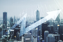 Abstract Creative Financial Diagram And Upward Arrow Hologram On Chicago Office Buildings Background, Growth And Development Concept