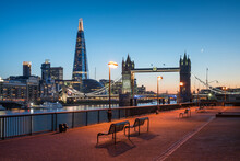On The Banks Of The River Thames At Night With View Of Tower Bridge And The Shard, London, Great Britain