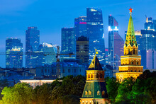 View Of The Moscow Kremlin Towers And Moscow City Skyscrapers During Evening Sunset Blue Hour