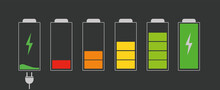 Battery With Different Charge Levels. Car Battery Indicator, Battery Charge Signs. Charging Energy Sign On A Dark Background With A Socket.