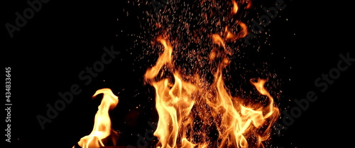 Canvas Print Flames Of Fire And Sparks Isolated On Black Background
