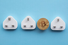Bitcoin Cryptocurrency Energy Consumption Concept. Gold Coin With Electric Plug