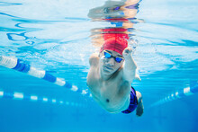 Underwater Paralympic Disabled Swimmer Young Latin Man Training In Pool, Disability Concept