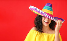 Beautiful Woman In Sombrero Hat On Color Background