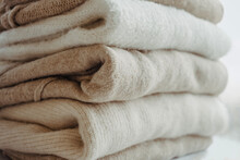 Cozy Milky Beige And White Natural Wool Sweaters, Folded On A White Background Close-up. Clothes Made Of Merino Wool, Alpaca, Natural Eco-fabrics. The Concept Of Conscious Consumption. Mockup