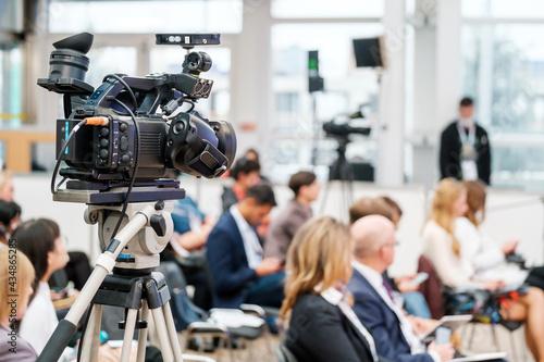 Crop videographer recording video during business seminar #434865285