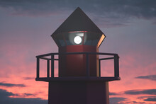Marine Active Lighthouse Tower. Sunset Or Dawn Sky In The Background