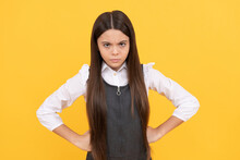 Becoming Disobedient. Disobedient Child Yellow Background. Frown Girl Stand With Arms Akimbo