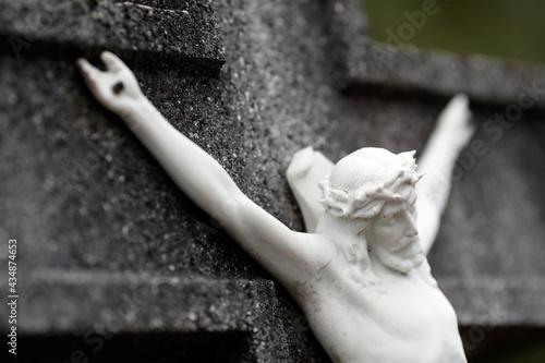 Obraz na plátně Grave in cemetery.  Crucifix. Jesus on the cross.