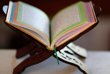 Open Holy Quran On Wood Stand.